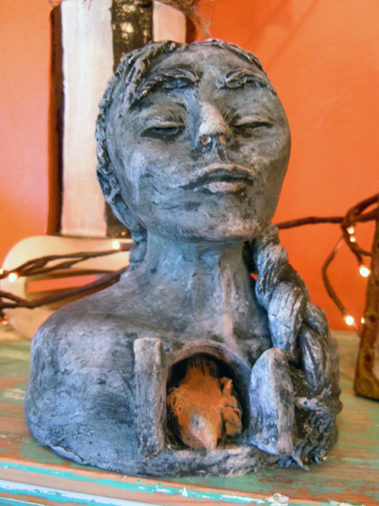 Clay girl with bird